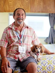 Richard Dubie, of Fair Haven, Mass., sits with his dog on the bed inside his 1966 Airstream Safari. Dubie was one of many who opened up their campers for tours at the second annual Vermont Vintage Trailer Show on Saturday, Aug. 20, 2016 in Montpelier.