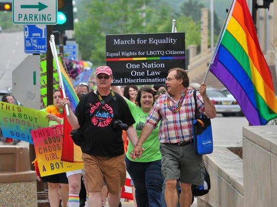 A line of people participates Saturday in the March for Equality, Wausau's second annual event in support of gay rights/marriage.