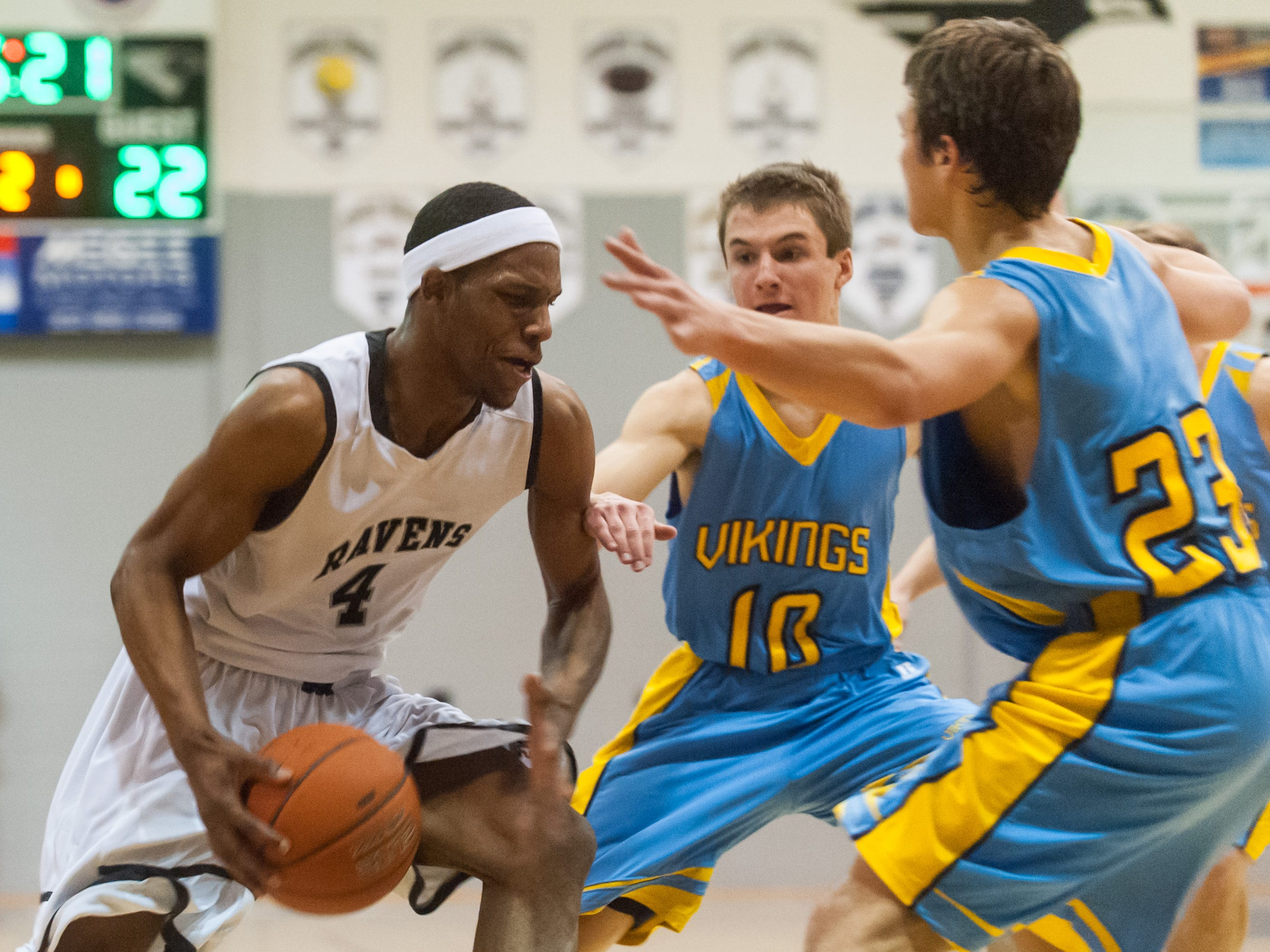 Sussex Tech forward Shi'wuan Sykes (4) drives against the Cape Henlopen defense on Friday night at Sussex Tech.