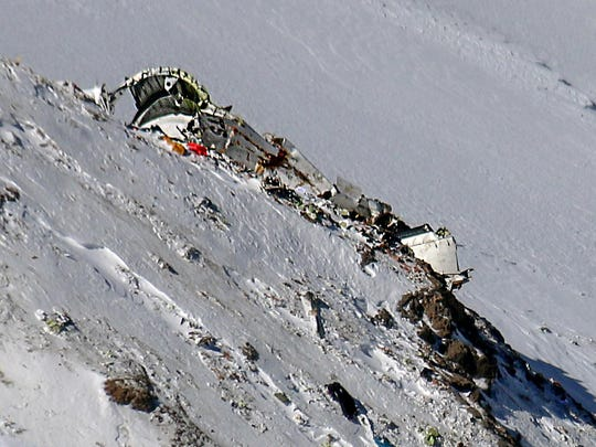 A picture shows on February 20, 2018 the wreckage of a plane that crashed near a mountain peak two days earlier in Iran's Zagros mountain range.