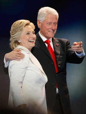 Hillary and Bill Clinton greet supporters after Hillary Clinton accepted the presidential nomination during the final night of the Democratic National Convention in Philadelphia Thursday.