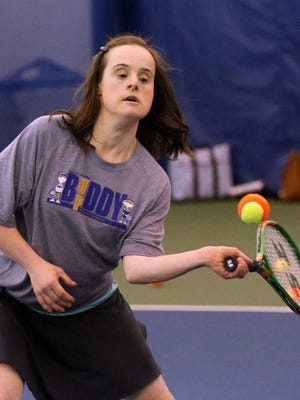 Heather Young plays tennis as part of the Buddy Up program on March 30, 2017.