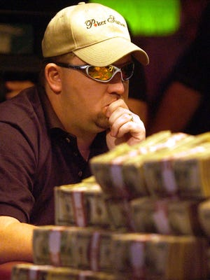 Chris Moneymaker plays the final hand of the World Series of Poker, May 24, 2003.