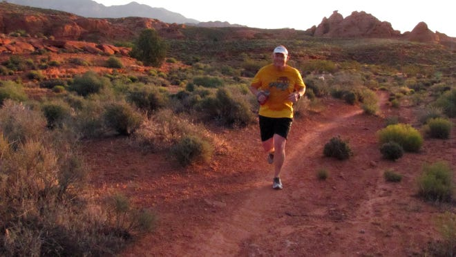 Justin Robins participates in a group trail run on the Prospector Trail in the Red Cliffs Desert Reserve on Wednesday, May 27, 2015.