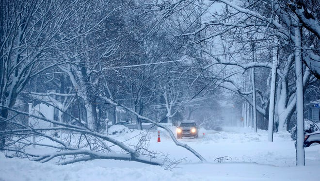 A tree and downed power lines lie across Winter Street in Hyannis, Mass., on Feb. 9 after winter storm Nemo plowed through.