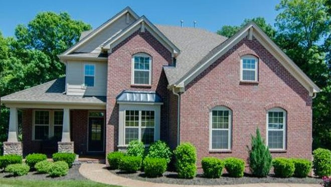 This four-bedroom Brentwood home has hardwood floors and high-end finishes. Features include screened and open decks and a private, tree-lined backyard.