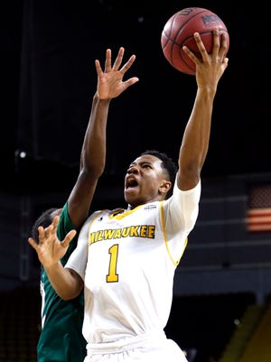 UWM's Jeremiah Bell drives to the basket.
