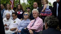 Hillary and Bill Clinton attend a Memorial Day ceremony