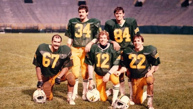Pictured after their final football game for St. Norbert College at Lambeau Field in Green Bay on Nov. 19, 1983, are from top left, Tom Fameree and Joe Doucette, and from bottom left, Dennis Lueck, Todd Schroeder and Jerry Lang.
