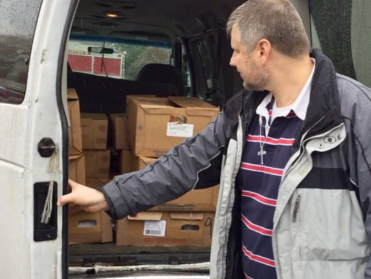 Ed Szybowski takes turkeys from the Community FoodBank