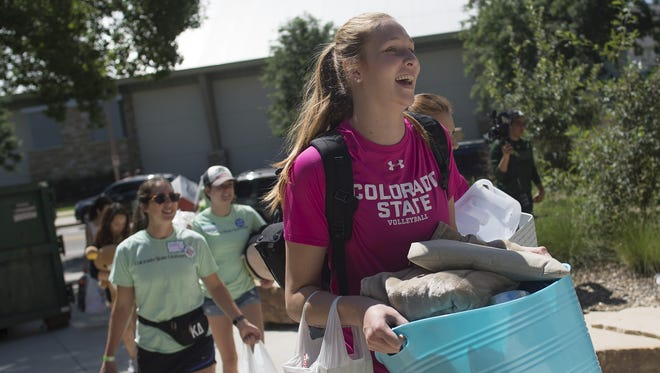 CSU volleyball player Kirstie Hillyer helps freshmen move into the dorms. Helping with move-in day is one of several community events the volleyball team participates in.