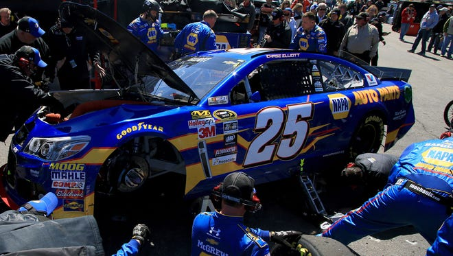 The crew for Chase Elliott's No. 25 Chevrolet works to repair it after contact with Brett Moffitt early at Martinsville Speedway.