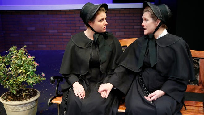 """Jim Bartu, from left, as Father Flynn and Kate Walker as Sister Aloysius in a scene from Civic Theatre of Lafayette's production of """"Doubt, a Prable"""" Tuesday, November 3, 2015, at the Monon Depot Theatre."""