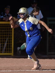 Reed's Rheanna Smith celebrates a home run during a regional playoff game against Bishop Manogue on Friday