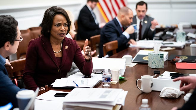 FILE -- Rep. Val Demings (D-Fla.), who served as one of the seven House Democratic impeachment managers, speaks with aides on Capitol Hill in Washington on, Jan. 20, 2020. Biden's advisers have conducted several rounds of interviews with a select group of vice-presidential candidates and have begun to gather private documents from some of them, as they attempt to winnow a field that features the most diverse set of vice-presidential contenders in history.
