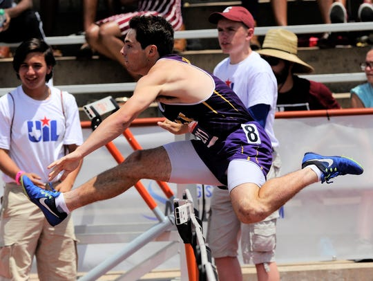 Wylie's Gatlin Martin clears a hurdle during the Class