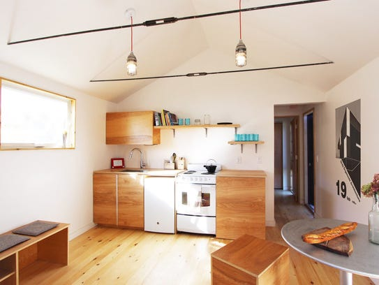 The kitchen of the tiny house built and designed by