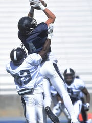 Nevada's Elijah Cooks (4) catches a touchdown during