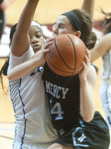 Eastern Eagles guard Markeia Porter collides with Mercy