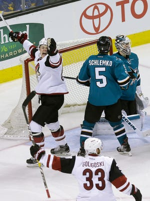 Arizona Coyotes left wing Lawson Crouse, left, and defenseman Alex Goligoski (33) celebrate after Ryan White scored a goal against the San Jose Sharks during the third period of an NHL hockey game in San Jose, Calif., Saturday, Feb. 4, 2017. The Coyotes won in a shootout, 3-2. (AP Photo/Jeff Chiu)