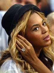 Photo taken in 2011 shows music superstar Beyoncé wearing a large ring during the Men's Final match at the U.S. Tennis Open in New York City's Queens borough.