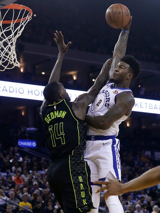 Golden State Warriors forward Jordan Bell (2) misses a dunk against Atlanta Hawks center Dewayne Dedmon (14) during the first half of an NBA basketball game in Oakland, Calif., Friday, March 23, 2018. (AP Photo/Jeff Chiu)