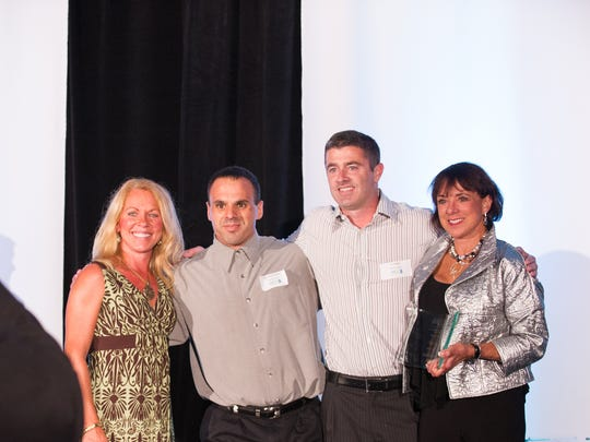 Clerisy Corporation CEO, Mary Maida, and colleagues, after winning the 2013 Healthcare Technology Award during the Digital Rochester Great Awards dinner in September.