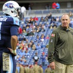 Titans interim head coach Mike Mularkey watches quarterback Marcus Mariota (8) as he warms up before the game against the Panthers at Nissan Stadium Sunday Nov. 15, 2015, in Nashville, Tenn.