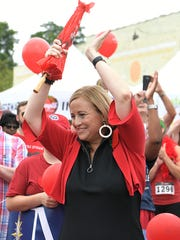 Mayor Megan Barry claps during a parade at the 14th