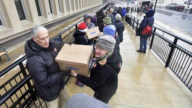 Volunteers deliver petitions with 400,000 signatures to the Secretary of State's office in Lansing on Dec 18, 2017, aiming to alter the way legislative districts are drawn in Michigan. Proposal 2, adopted this month, takes redistricting authority from state lawmakers and gives it to an independent, 13-member commission.