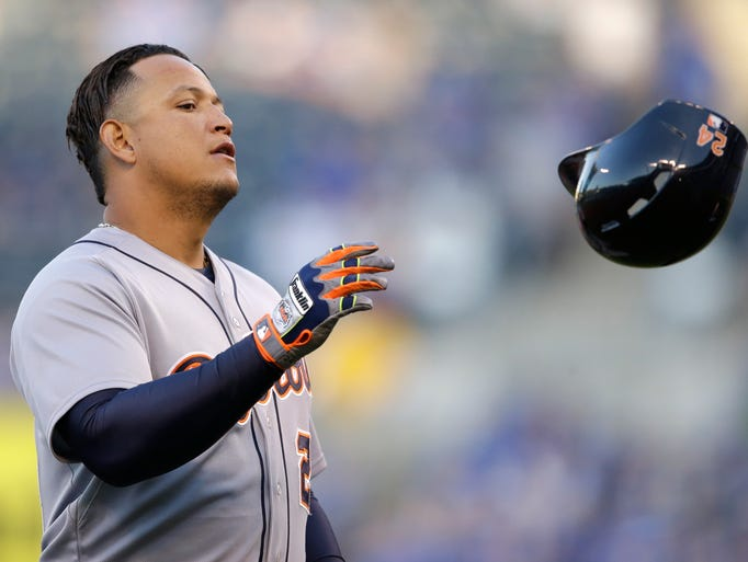 The Tigers' Miguel Cabrera tosses his helmet after