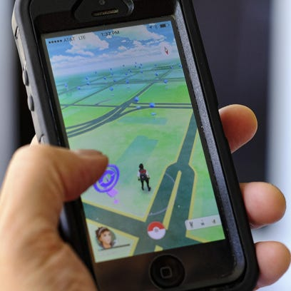 """Richard Vogel/AP""""Pokémon Go"""" is displayed on a smartphone in Los Angeles. The game's origins are as peculiar as any of the creatures inhabiting it. FILE - In this Friday, July 8, 2016, file photo, """"Pokemon Go"""" is displayed on a cell phone in Los Angeles. Pokemon Go's origins are as peculiar as any of the creatures inhabiting the game. (AP Photo/Richard Vogel, File)"""