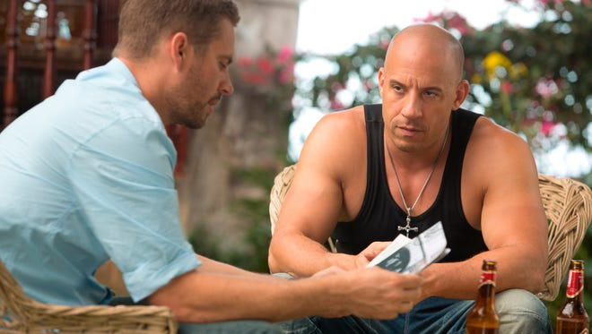 Brian (Paul Walker, left) and Dom (Vin Diesel) share their traditional barbecue in 'Fast & Furious 6.'