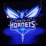 The Charlotte Bobcats unveil their new branding logo as the Charlotte Hornets.