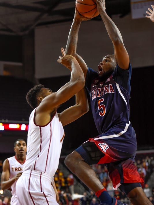 Arizona guard Kadeem Allen (5) drives on Southern California forward Charles Buggs, left, for a basket during the first half of an NCAA college basketball game, Thursday, Jan. 19, 2017, in Los Angeles. (AP Photo/Gus Ruelas)