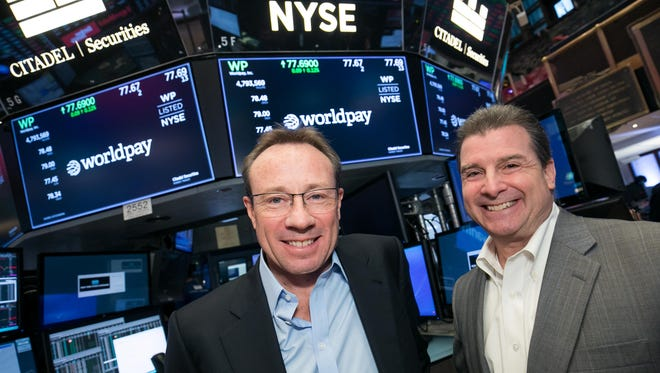 Worldpay Co-CEOs Philip Jansen and Charles Drucker at the The New York Stock Exchange on Tuesday after announcing the close of Vantiv's merger with London-based Worldpay. The combined company will be headquartered in Cincinnati with Drucker also serving as board chairman.