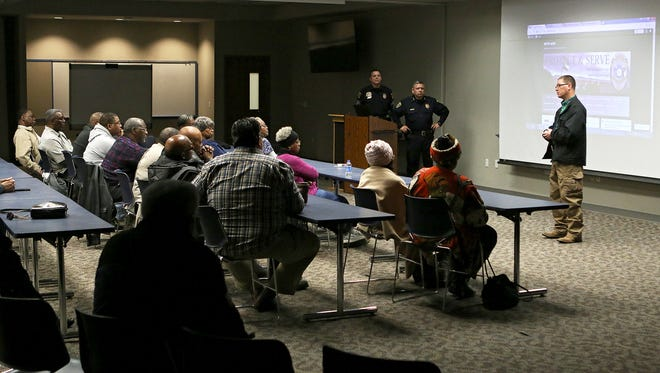 Wichita Falls Detective David Raines talks with several dozen concerned pastors and community members about two elderly women that were recently robbed while leaving their churches. The meeting was held Saturday at the Wichita Falls Public Safety Training Center.