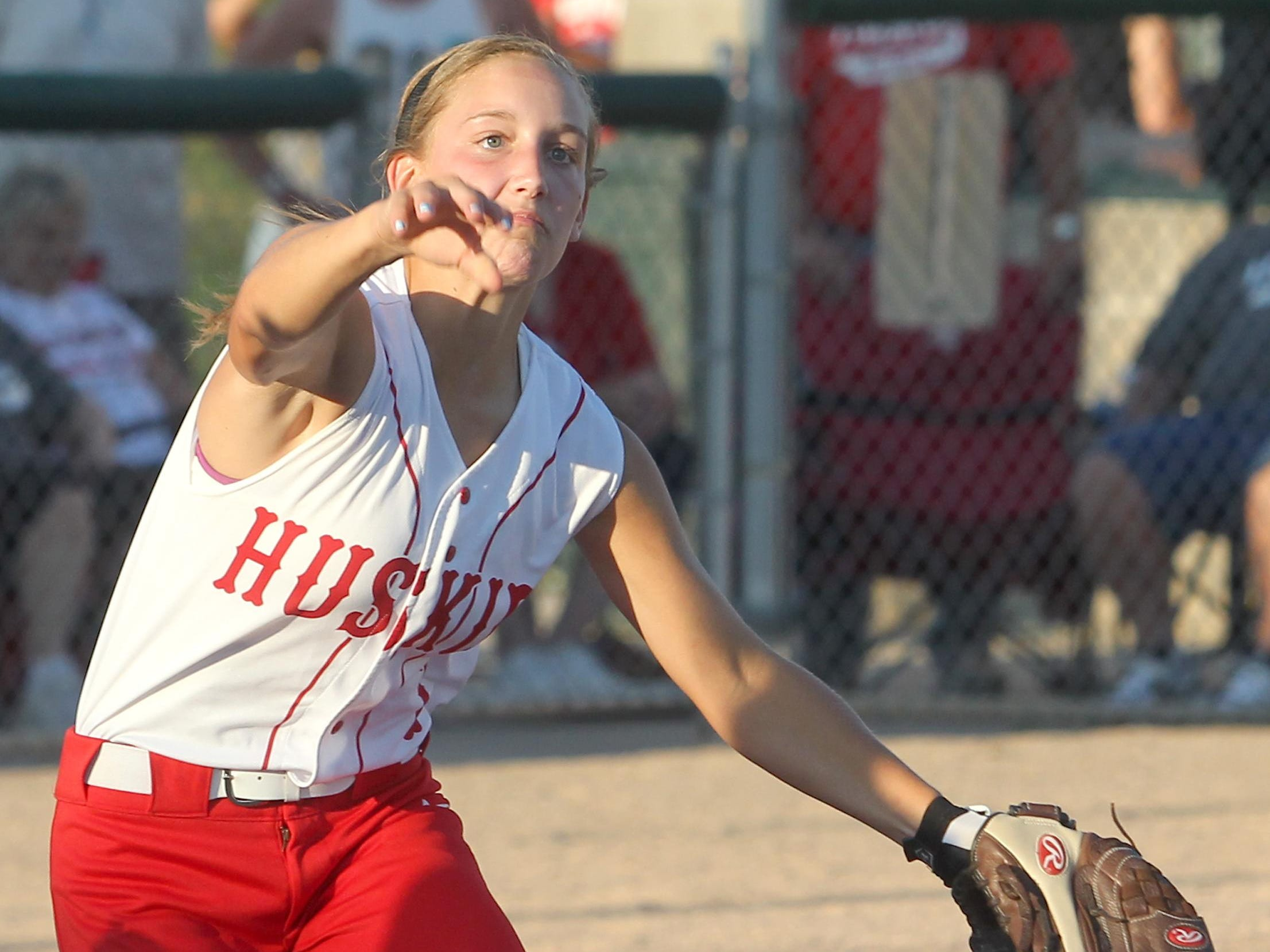 Highland's Cheyann Adamson makes the play to first during their game against Regina in Iowa City on Monday, July 15, 2013. Benjamin Roberts / Iowa City Press-Citizen