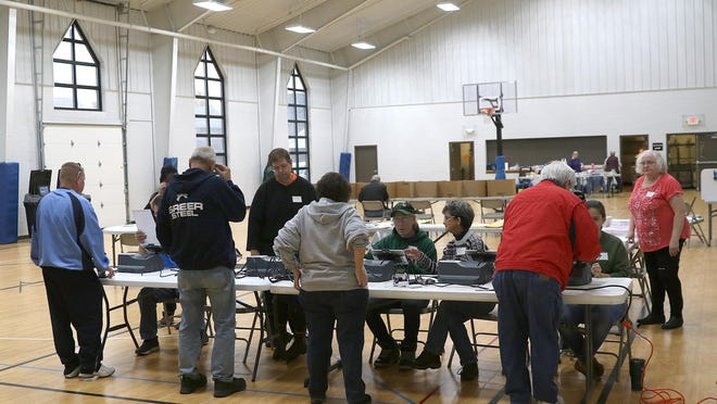 Voters and poll workers turned out at the new location of the Dover Precinct 3-C at the Dover Alliance Church last November.