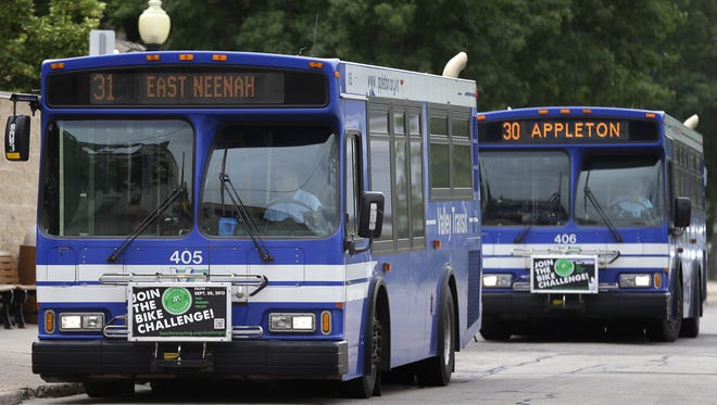 A Valley Transit bus makes a stop in downtown Neenah.