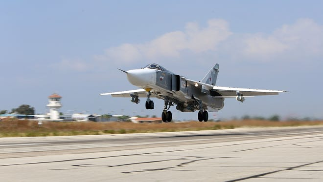 A Russian Sukhoi SU-24 bomber takes off from the Hmeimim airbase in the Syrian province of Latakia on Oct. 3, 2015.