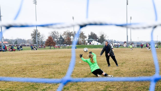 Brian Crafton helps goalie Ashby Greenwell warm up before a match in the Veterans Invitational Soccer Tournament played at Evansville's Goebel Soccer Complex Sunday, November 12, 2017.
