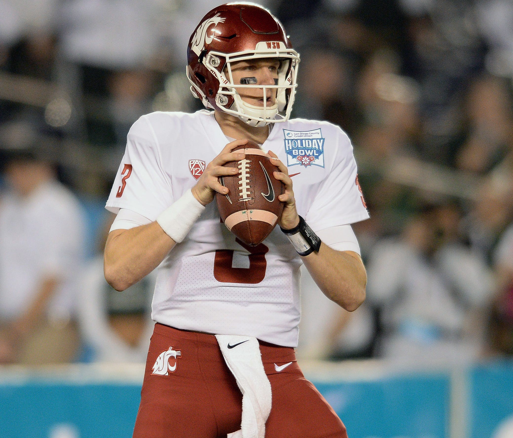 Former Washington State quarterback Tyler Hilinski looks to pass during the first quarter against Michigan State in the Holiday Bowl at SDCCU Stadium in San Diego on Dec. 28, 2017.
