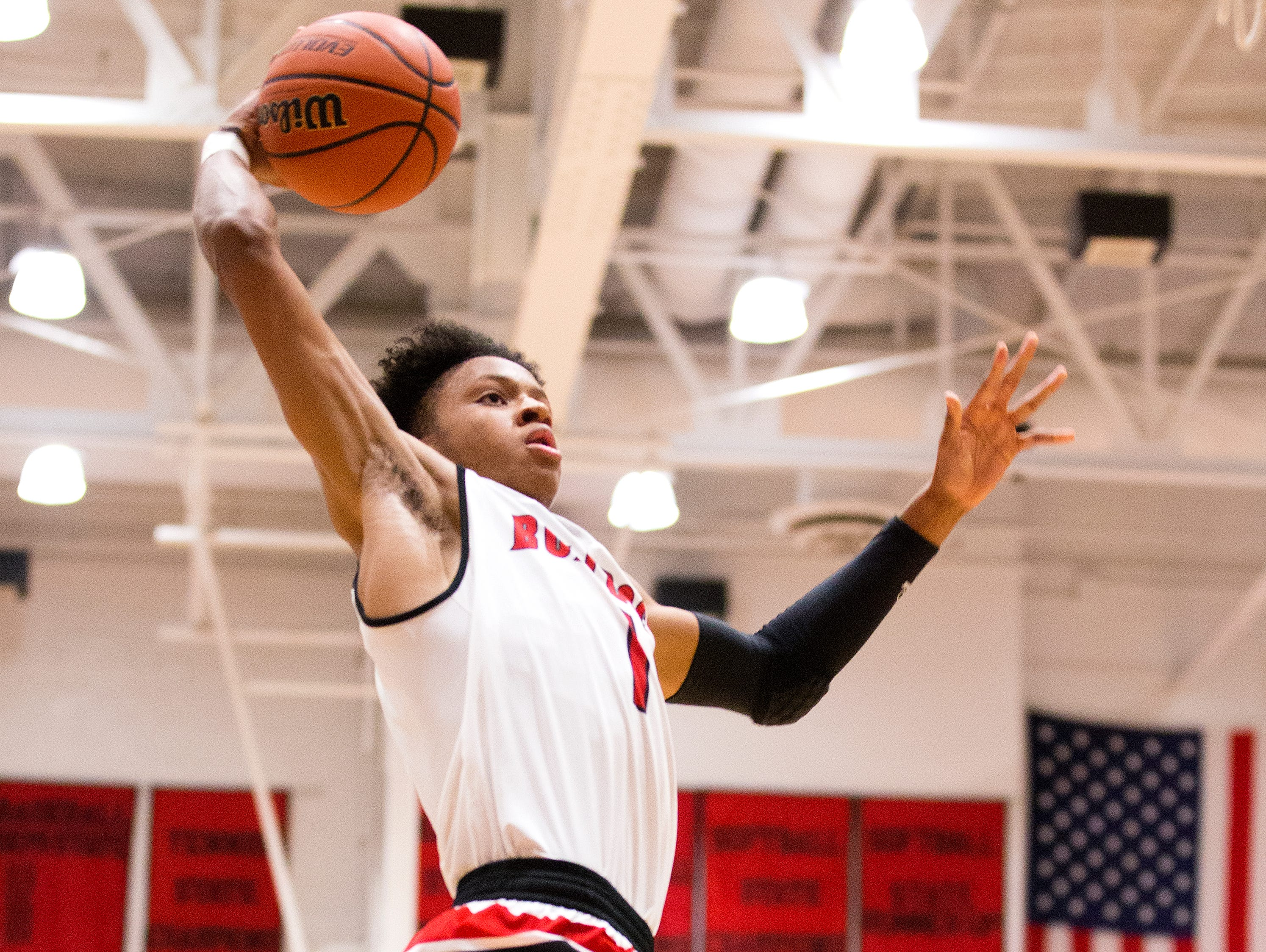 New Albany's Romeo Langford (1) dunks the ball during the game between New Albany and Evansville Bosse at New Albany High School.
