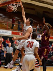 St. Cloud State's Jon Averkamp (24) dunks the ball