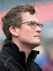 Author John Green listens to the national anthem before the Angie's List Grand Prix of Indianapolis, Saturday, May 14, 2016, Indianapolis Motor Speedway.