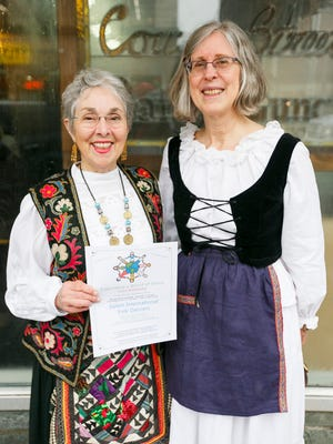 Marcia Hoak, left, and Emily Wieczorek, right, came to Holding Court to invite members of the community to experience the world of dance on Wednesday evenings with the Salem International Folk Dancers.