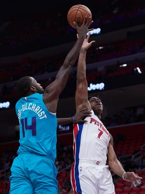 Oct 4, 2017; Detroit, MI, USA; Charlotte Hornets forward Michael Kidd-Gilchrist is fouled by Detroit Pistons forward Stanley Johnson in the first half at Little Caesars Arena.