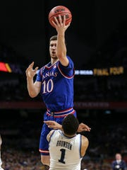 Kansas guard Sviatoslav Mykhailiuk shoots against Villanova