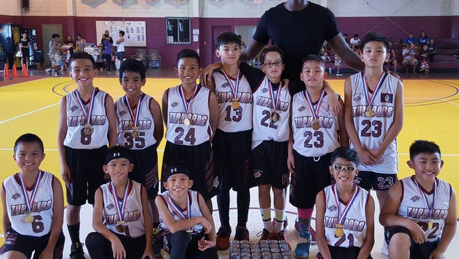 12U Tamuning Typhoons defated TamFam 49-25 for the title in the 2016 Thanksgiving HoopFest Tournament.